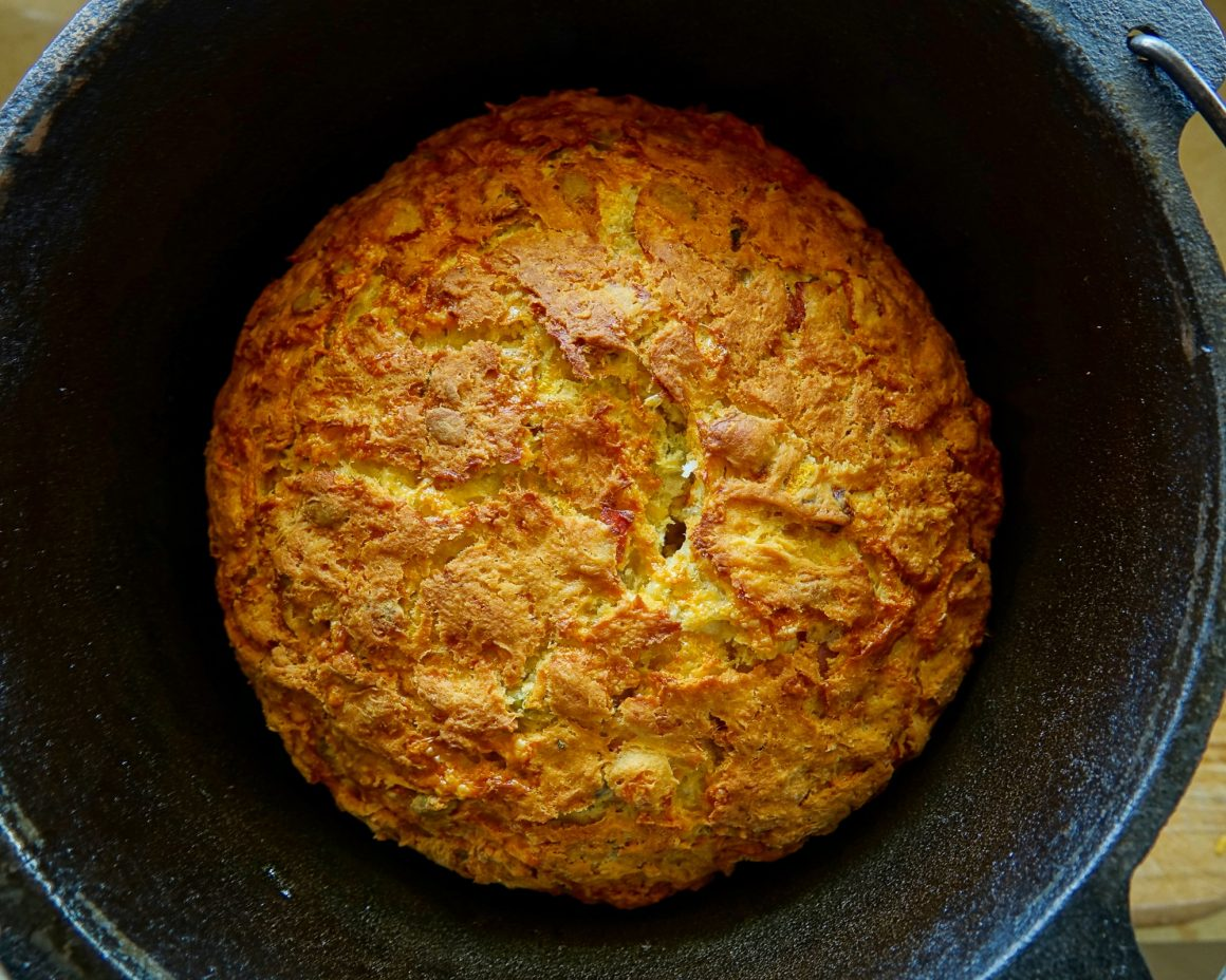 Cheesy pumpkin and bacon damper cooked in a cast iron pot