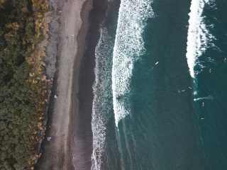 Aerial view of black sand beach in Raglan, New Zealand